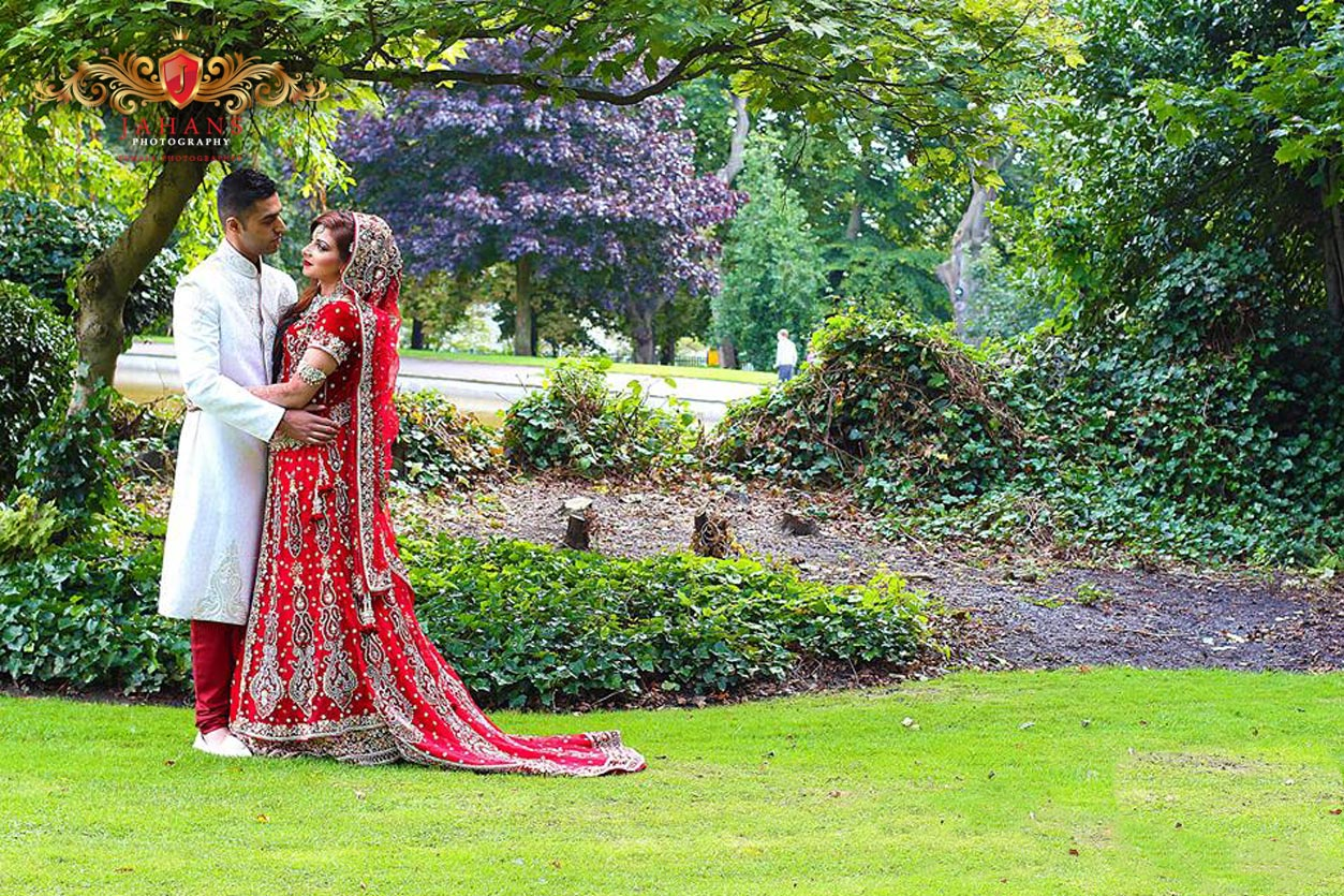 photograph of newly wed asian pakistani couple in the park
